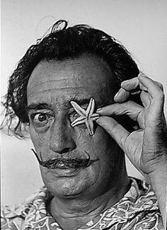 Salvador Dali with sea star 'eyepiece'