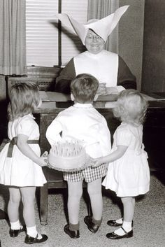 Sister Mary Alice Rowan from St Vincent's orphanage in Chicago being presented with a surprise birthday cake