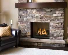 I like the big stones on the fireplace, could see putting them in around the wall on mine!