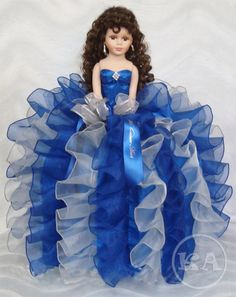 Quinceanera doll in royal blue dress. http://www.heidicollection.com