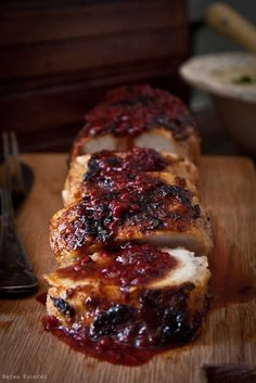 Pork Tenderloin with Cranberry-Raspberry Sauce - For Low carb sub the bit of sugar and try the old low carber trick of replacing orange juice (this recipe uses 1/4 cup) with a lemon juice/orange extract/Splenda combo / JuJu Good News