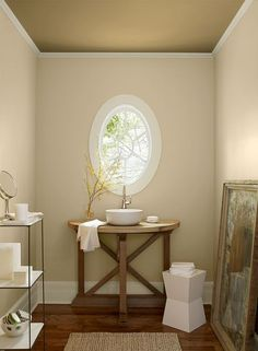 Looking for an elegant bathroom color scheme? Try Benjamin Moores Sepia Tan on the walls; Richmond Gold on the ceiling and Albescent on your trim.