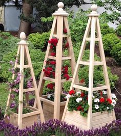 Natural accoya obelisks with Chevy Chase red roses at RHS Chelsea Flower Show
