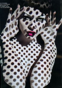 Not sure I'd use polka dots, but I like the idea of putting transparent patterns over a photo shoot using light...cool