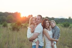 Family photo in field at sunset.  Winston Salem Family Photographer