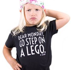 Dear Monday Go Step on A Lego shirt. This design is hand screen printed on a very soft black shirt. How does this style fit? Kids shirts true to size, cut to be slightly more fitted than a normal boxy tee. When will my shirt ship?  Your order will ship out within 1 business day.  How can I style this top?  Check us out on Instagram feed at www.instagram.com/b.gatsby for examples. What other products do you sell? See more of our products in our shop at www.BGatsby.com.   Kids Graphic Tee,...
