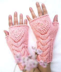 Hand knit beauty fingerless gloves. Gift for her! This pair of fingerless gloves is hand-knitted in wool-acrylic yarn in pink color, with crocheted hearts. It is perfect for keeping you modish and warm. Size M. Material:merino-wool-50%, acrylic-50%. This item should be hand washed in warm