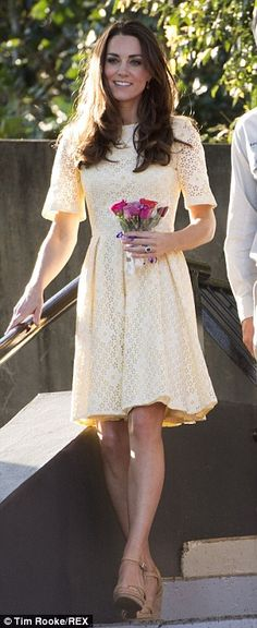 Zoo time: The Duchess wore a pretty lemon yellow broderie anglaise number by an independent dressmaker