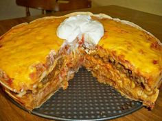 ~~MEXICAN TORTILLA CASSEROLE~~~ 1lb. ground beef 1/2 cup diced onion 1 pack taco seasoning mix 2 cups shredded cheddar cheese 1 can refried beans (thet spread easier if you warm them in microwave) 1 cup prepared rice (I used Minute Rice) 1 can Mexican blend corn (DRAINED)will only use about 1/2 can 4-5 large flour tortillas 8 oz of thick chunky salsa (your choice mild or hot) Spray a spring form, round cake pan or casserole with cooking spray Brown ground beef ,and onion and drain Add taco…