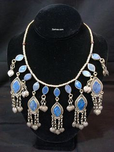 Tribal Afghan Necklace - This elegant necklace features Lapis Lazuli stones mounted on dangle pendants. They are attached on a cotton cord with small metal alloy. The necklace measures 20 inches long. Price: $29.99  Product ID: LAPISNECK