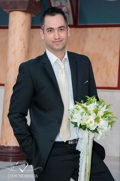 Groom is waiting the bride holding a wedding bouquet of white daisies, lilies and greenery! For more: https://www.instagram.com/diamond_event_planners/  https://plus.google.com/u/0/+DiamondeventsGr  https://gr.pinterest.com/diamondwedding/  https://www.facebook.com/Diamond-Event-Planners-176242063682/  http://diamondevents.gr/ #weddingideas #weddingplanner #weddingreception   #weddingtime #white #wish #wishbook #wishes #wishtable #emirati #party #birthdayparty #weddingspecialist…