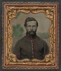Unidentified soldier in Union artillery corporal's uniform in front of painted backdrop showing a forest Library of Congress
