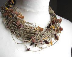 Golden raindrops - linen necklace  100% Handmade  Colors •linen-beige •gold beads   Materiais: •linen •gold beads •jewelry clasp  Measurement: 50cm/ 20   Thanks you