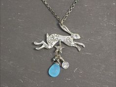Silver Leaping Hare Pendant with Star, blue Chalcedony, Moonstone and black Pearl.