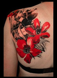 I really love these tattoos with a splash of red in a mostly grey & black tattoo.