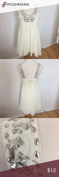 C58 Cream Dress with Flat Silver Beads Fancy cream/very light yellow, depending on the light, dress with flat silver beads on the neckline and straps. Has a few loose strings and one small patch of missing beads but is not very noticeable. Juniors size large. bizz Dresses Mini