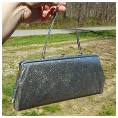 Check out this item in my Etsy shop https://www.etsy.com/listing/288564489/vintage-silver-metallic-purse-leather-or