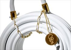 """Garden Glory Hoses """"Our mission was therefore to create a playful but, at the same time, elegant package. Something that would communicate the fact that Garden Glory hoses are one of a kind. Label Design, Packaging Design, Garden Hose, Luxury Handbags, Garden Design, Bling, Style Inspiration, Purses, Creative"""
