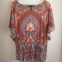 Printed shirt Orange and gray printed shirt in great condition. Boat neck, Dolman sleeves. 100% nylon. INC International Concepts Tops Blouses