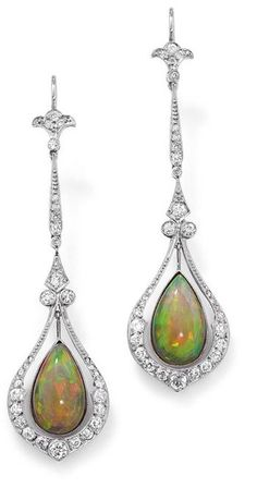A pair of opal and diamond ear pendants  Each designed as a central millegrain-set pear-shaped opal suspended within an  articulated drop-shaped frame set with circular-cut diamonds to a tapered and foliate  similarly cut diamond surmount, length 6.5 cm, wire earfittings.