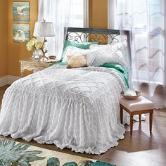 Instead of worrying what will be the star color of your room, instead consider taking a lovely neutral, like a stunning chenille bedspread in a wispy white, then let your accent pieces drive the color story. Choose a lovely accent shade to fill your walls, then pick one hue, such as a seaworthy shade of blue, to feature in wall art, a large floor rug and throw pillows.