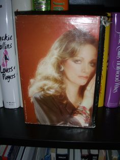 Fave Jackie Collins book picture. Hmm, what is Ms. Collins thinking about?