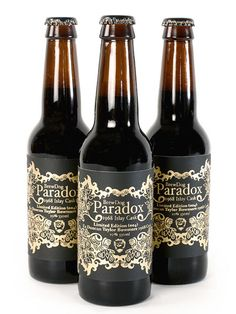 Silk screen printed labels for Scottish Brewery BrewDog's first anniversary special edition beer, Paradox. Hand printed in gold lacquer on black.  — Johanna Basford