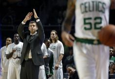 Boston Celtics coach Brad Stevens calls for a timeout during the second half of a preseason NBA basketball game against the New York Knicks in Providence, R.I., Wednesday, Oct. 9, 2013. (AP Photo/Elise Amendola)