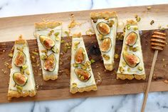 A subtly sweet and tangy tart made with a creamy mascarpone and Greek yogurt filling in a pistachio and black pepper shell; topped with fresh figs, crunchy pistachios and sweet honey.