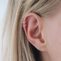 Delicate cartilage hoops perfect for tragus or helix piercings. #Piercings