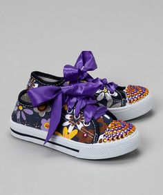 These sturdy sneakers are bedazzled in rhinestones and laced with ribbons for a look that's one part cute, one part glam and all parts groovy.