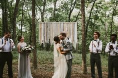diy backyard wedding in the woods, ceremony, woven wall hanging backdrop, first kiss. Kansas City, Missouri | Mary + Dillon | Aaron & Whitney Photography