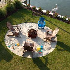"Mini beach with ""bonfire"" in the lawn."