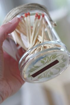 Thriftstore jar.  Bottom lined and strike pad attached.  Adorable and perfect with candles as a gift.
