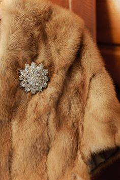 fur & brooch