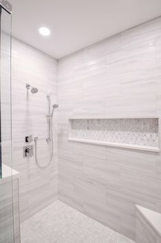 In this spaciously glamorous walk-in shower, our designer added a lengthy, showstopping niche. It quickly became the focal point for the whole bathroom. Bathroom Niche, Master Bathroom Shower, Upstairs Bathrooms, Bathroom Layout, Bathroom Interior Design, Small Bathroom, Modern Bathroom Tile, Bathroom Ideas, Niche In Shower