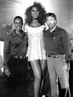 In a famous, but not as busy as now, RuPaul guest-starred on Chuck Norris' action series Walker, Texas Ranger, dwarfing both Norris and costar Clarence Gilyard. Country Music Stars, Country Music Singers, Rupaul, Chuck Norris Movies, Burt Young, Nia Peeples, Walker Texas Rangers, Homeless Man, And Peggy