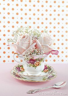Baby roses in a cup by Cadfael1979, via Dreamstime