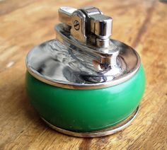 Vintage 1950s Art Deco-style Emerald Green Rolstar table lighter.