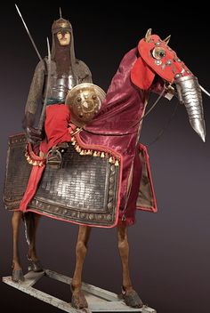 An Indian  armour for  man and  horse, the  mounted  figure's  armour partly 17th and  19th century,  the horse  armour in  Indian 16th/  17th century  style.