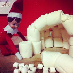 Elf on a shelf making an igloo.