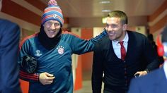 Bastian Schweinsteiger and Lukas Podolski before Arsenal-Bayern