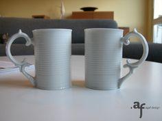 Agaf Design Can Mugs on a coffee table