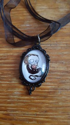 Cute Little Dead Girl Necklace by AwesomeOddities on Etsy