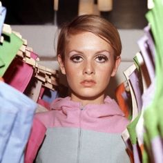 Twiggy. Among dresses.