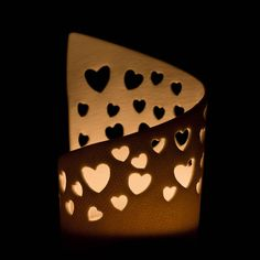 Delicate Translucent Pierced Porcelain Hearts Tea Light Candle Holder Made from thin slabs of translucent porcelain clay, decorated with pierced different sized hearts. This Tea Light holder has not been glazed as the results are that the porcelain is . Hand Built Pottery, Slab Pottery, Ceramic Pottery, Porcelain Clay, Ceramic Clay, Clay Projects, Clay Crafts, Cerámica Ideas, Pottery Courses