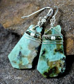 Chrysocolla slab sterling silver wire wrapped earrings with freshwater pearls and pyrite.  These rest on sterling silver ear wires.  Super cool!  I love the rustic, boho look of these. @)--;----- These earrings measure about 2 1/4 inches.