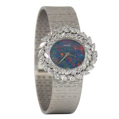 This Piaget White Gold, Diamond and Opal Bracelet watch is so feminine and pretty! Patek Philippe, Opal Jewelry, Bling Jewelry, Devon, Cartier, Omega, Art Deco Watch, Diamond Bracelets, Watches For Men