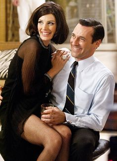 Megan and Don Draper on 'Mad Men'. Love her bisu dress!