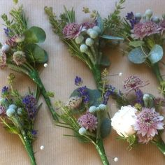 Groom & Bridal party buttonholes created by Eden Blooms Florist from Pink Astrantia, Lavender, Brunia, Rosemary, Thyme, Eucalyptus & Bombastic Rose.